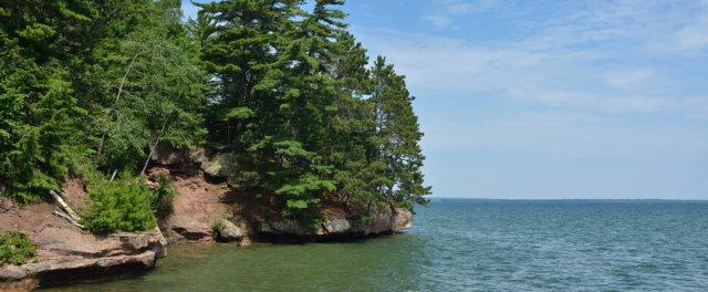 A rocky shoreline on a large lake