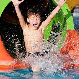 Boy sliding down waterslide