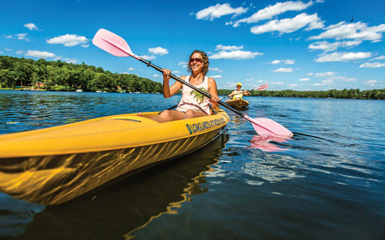Woman paddling in a kayak