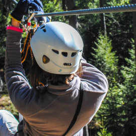 A person starting down a zipline