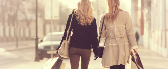 Two women shopping down the street