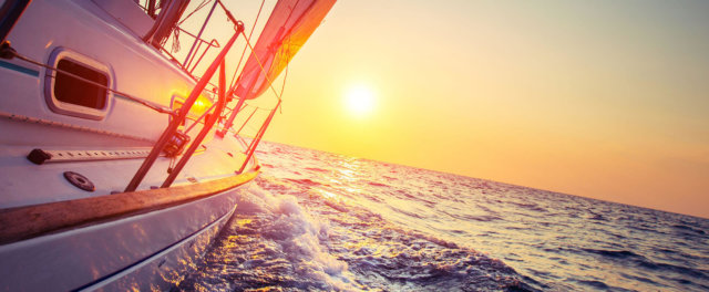 A sailboat careening into the sunset