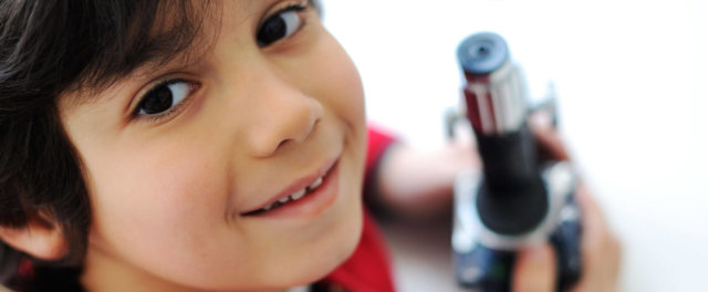 A boy with a microscope