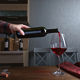 Pouring a glass of wine from a wine bottle