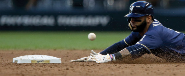 A baseball player sliding into base