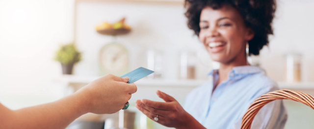 A woman shopping with a credit card