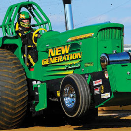 Green tractor on display outside
