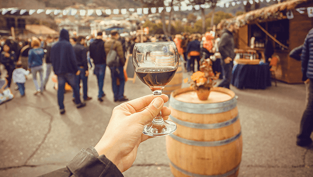 holding wine glass at festival