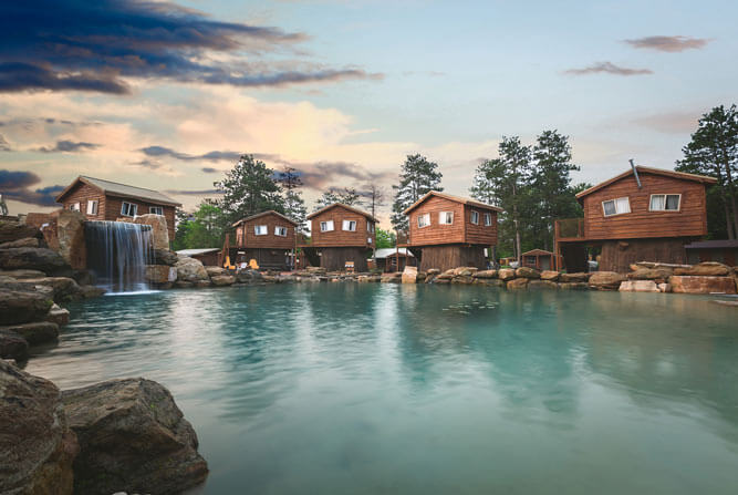 American Resort & Treehouses view from across the Natural Lagoon